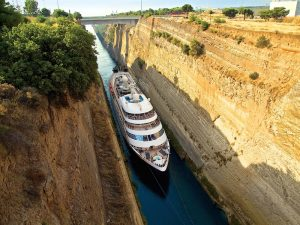 the corinth canal connecting the gulf with the ionian sea and through which trade and pleasure ships can pass