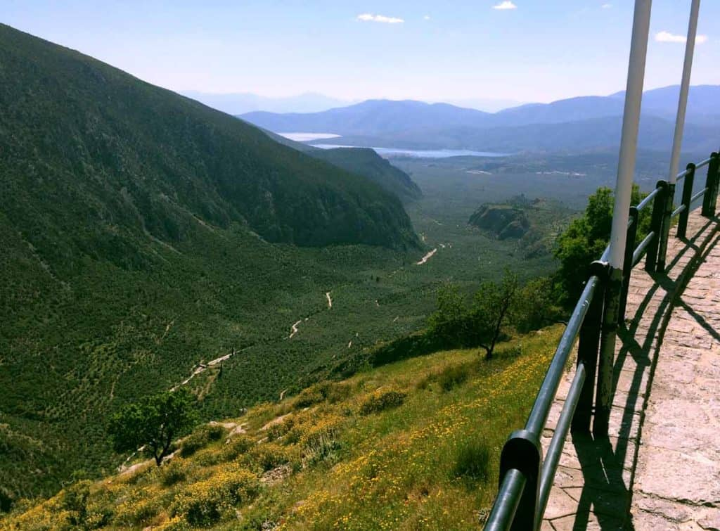 the valley is underneath the archaeological site of Delphi with a view to the sea