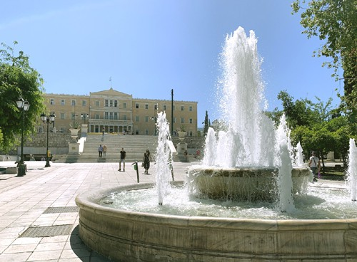 athens main square showing its fountain behind which is the Athens Parliament building