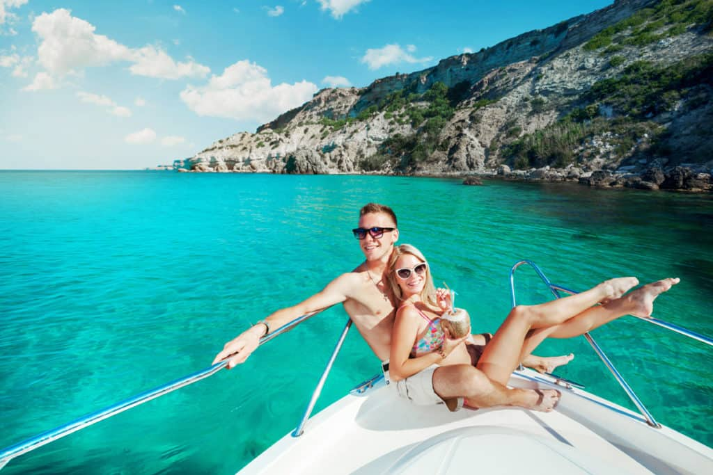 Couple resting on a yacht at sea. Luxury holiday vacation. cyclades skippered sailing holidays