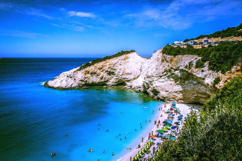 sandy beach with blue sea in Lefkada is ideal for Ionian skippered sailing holiday