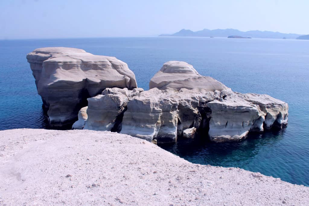 coastline of Milos Island with white caves is easy to navigate for sail boats. Cyclades skippered sailing holidays