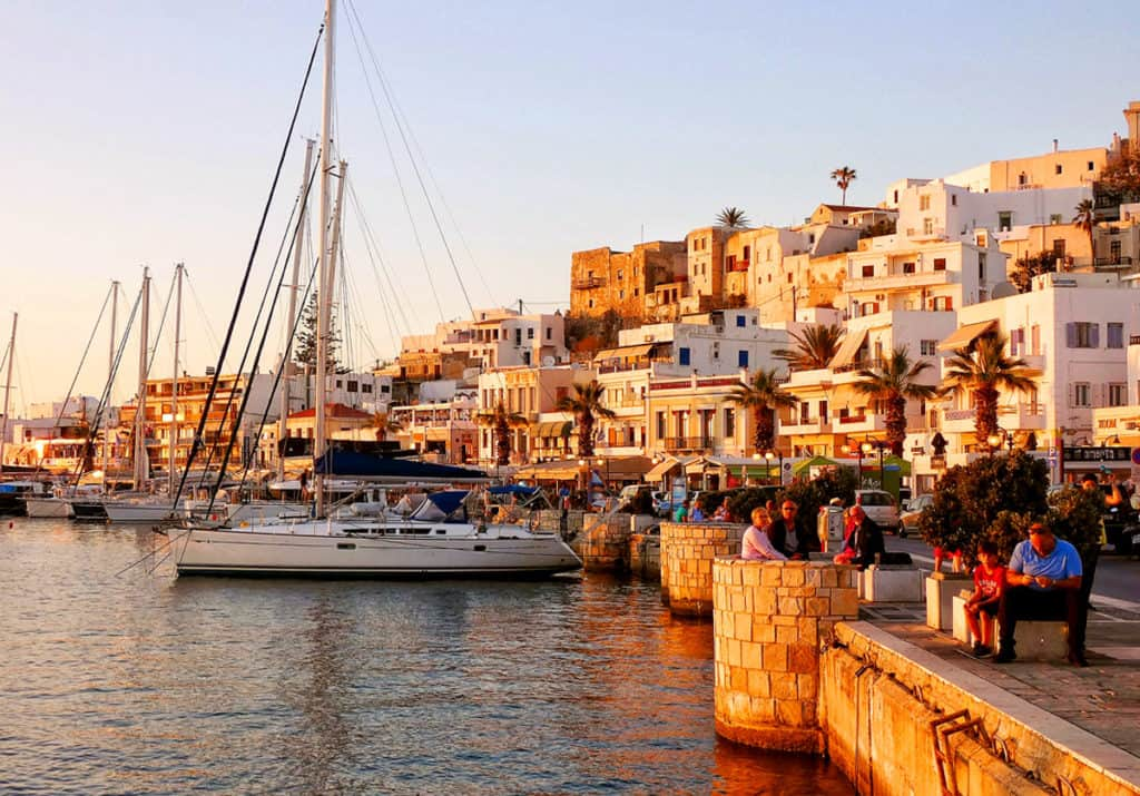 port of naxos with pretty houses and sailing yachts. Cyclades skippered sailing holidays