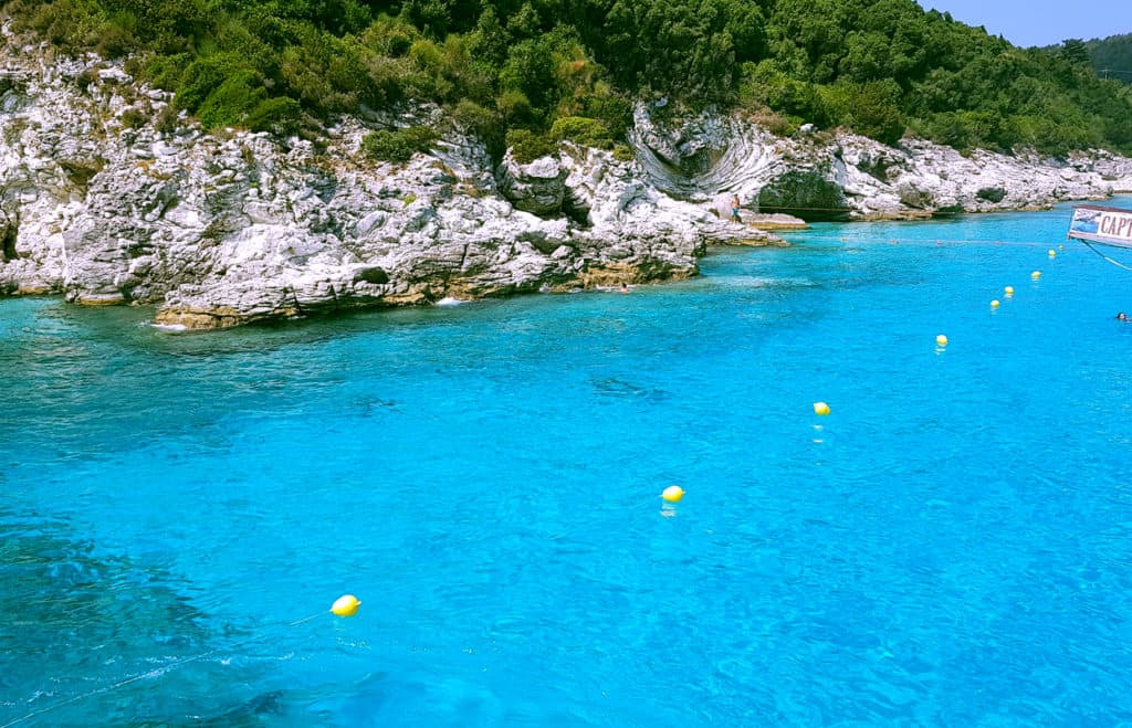 the shore of Paxi with its caves and chrystal clear blue water during our skippered sailing holidays