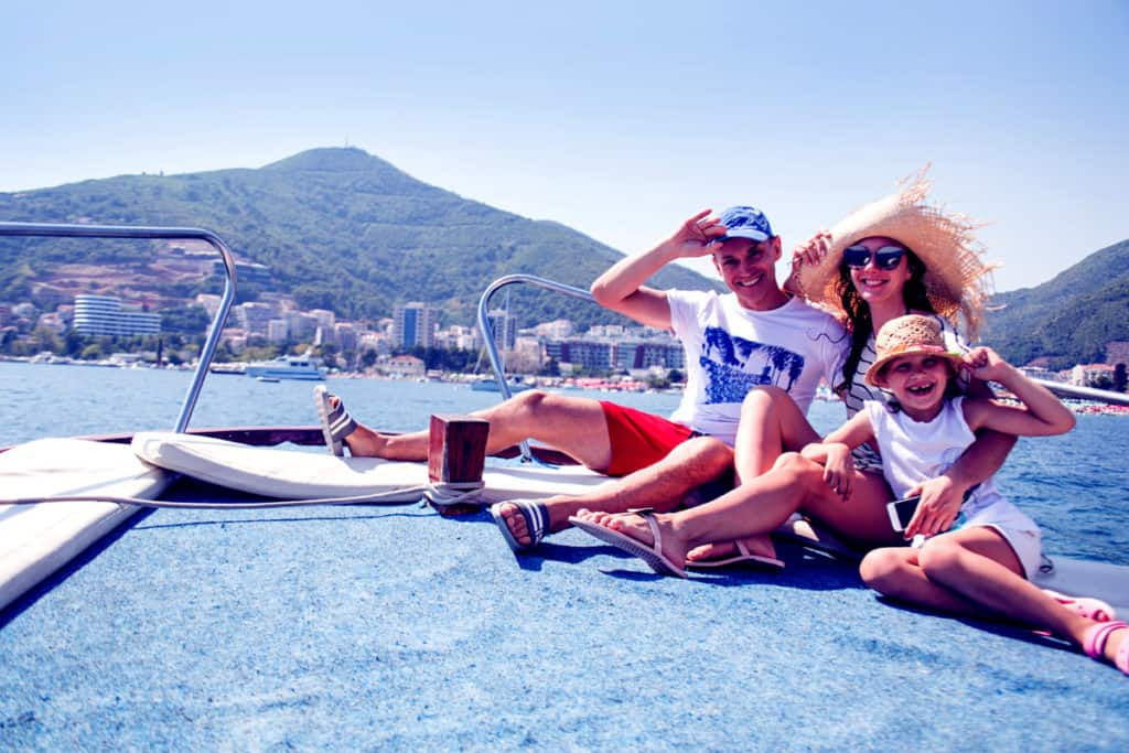 Happy family with children enjoy relaxing on a crewed yacht at sea in greece