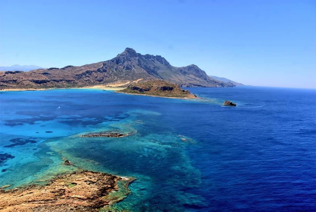 rugged moountains and deep blue sea in Crete coastline