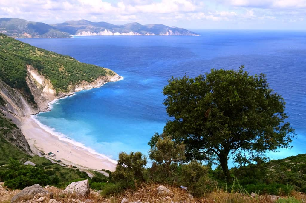 a green ionian island view towards the blue sea and white cliffs of the opposite shore