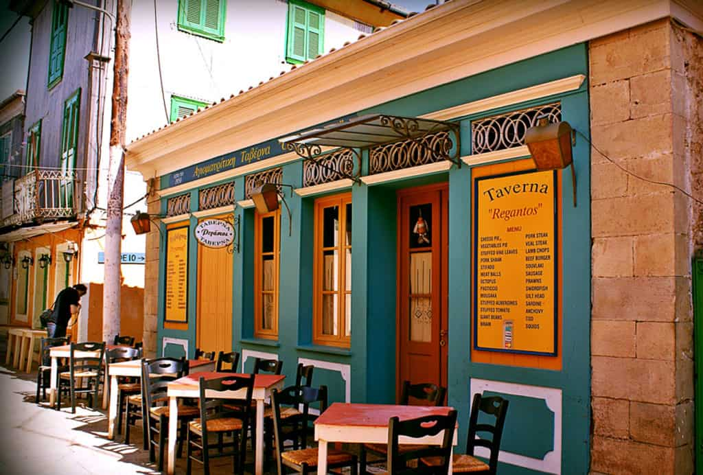 a small cafe ready for customers in an ionian island village