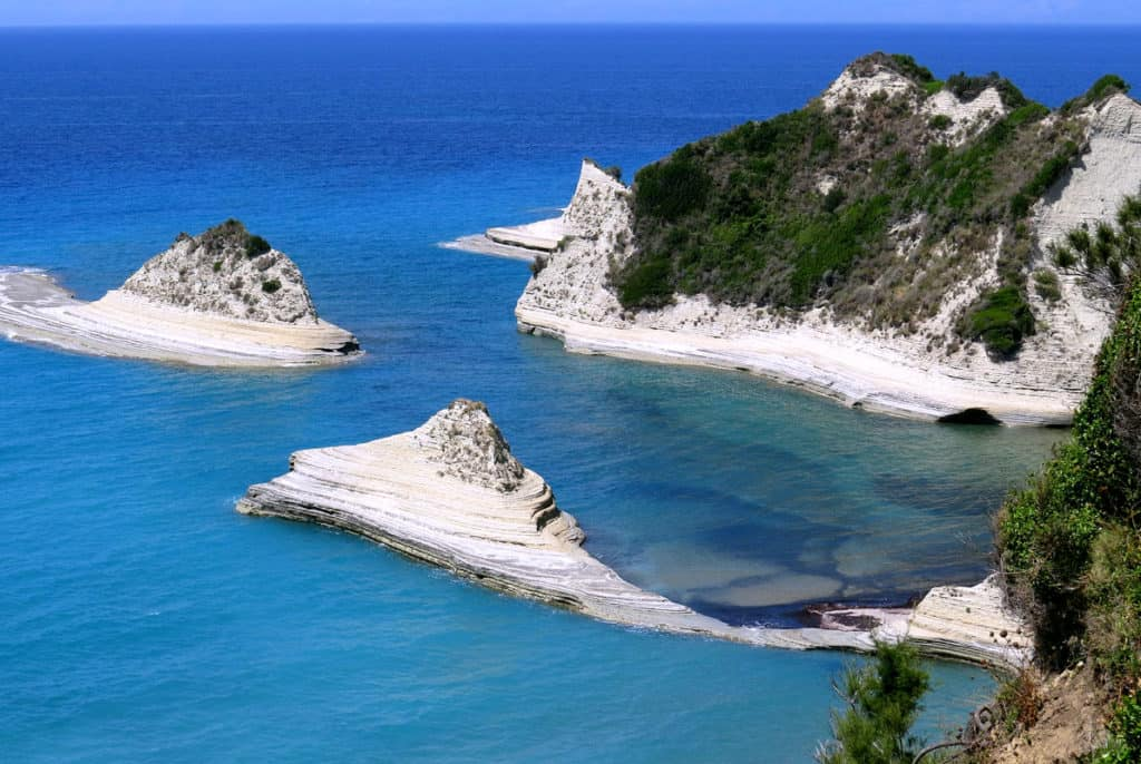 caves and white cliffs and shore along an ionian island in greece