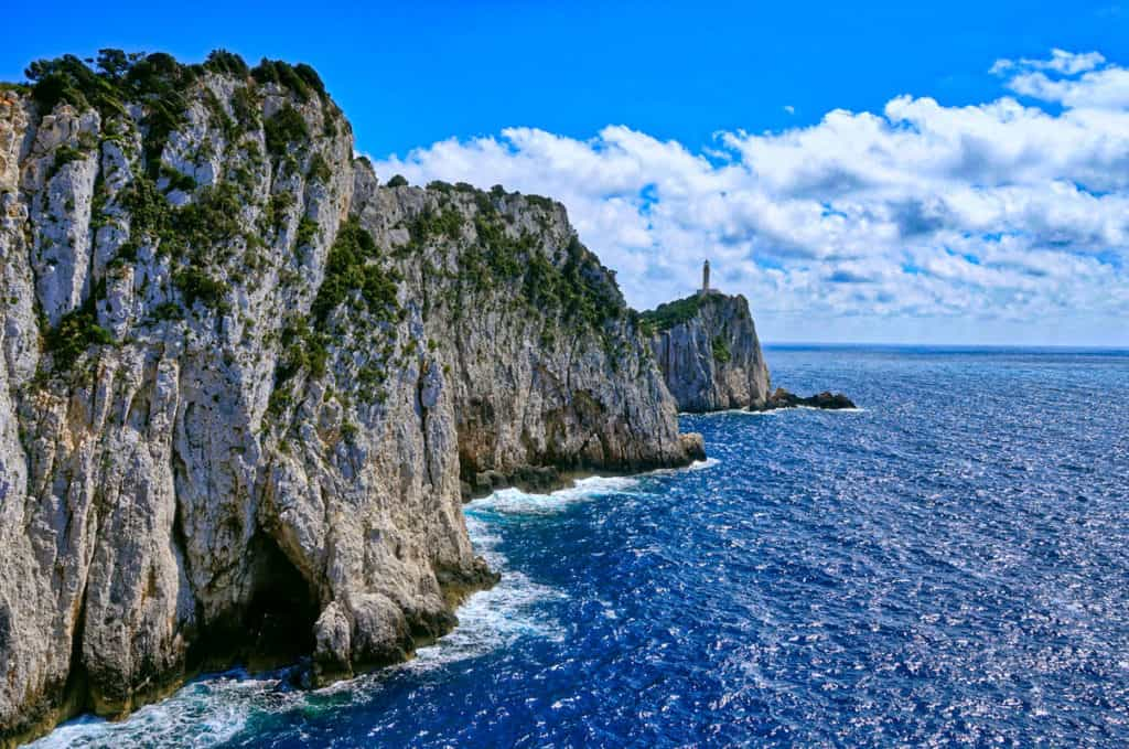 rugged cliffs of an ionian island with the deep blue sea