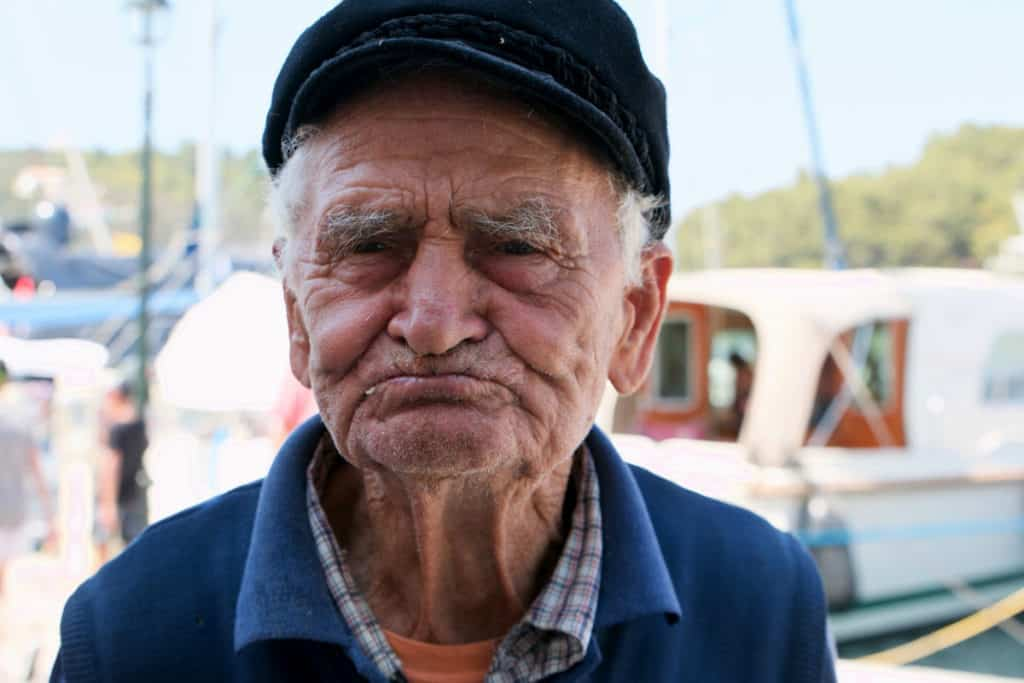 a fisherman from an ionian island poses for a photo