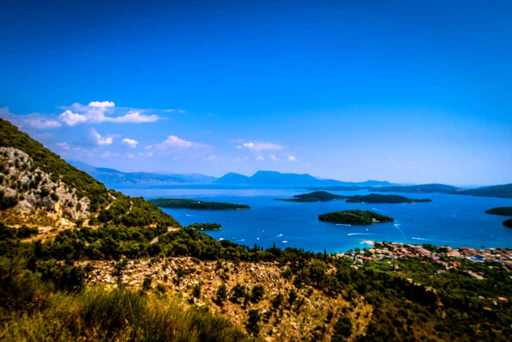 a green ionian island view towards the deep blue sea