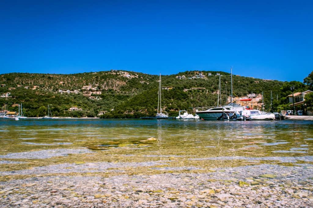 sailing yachts anchor at a small bay in the ionian islands