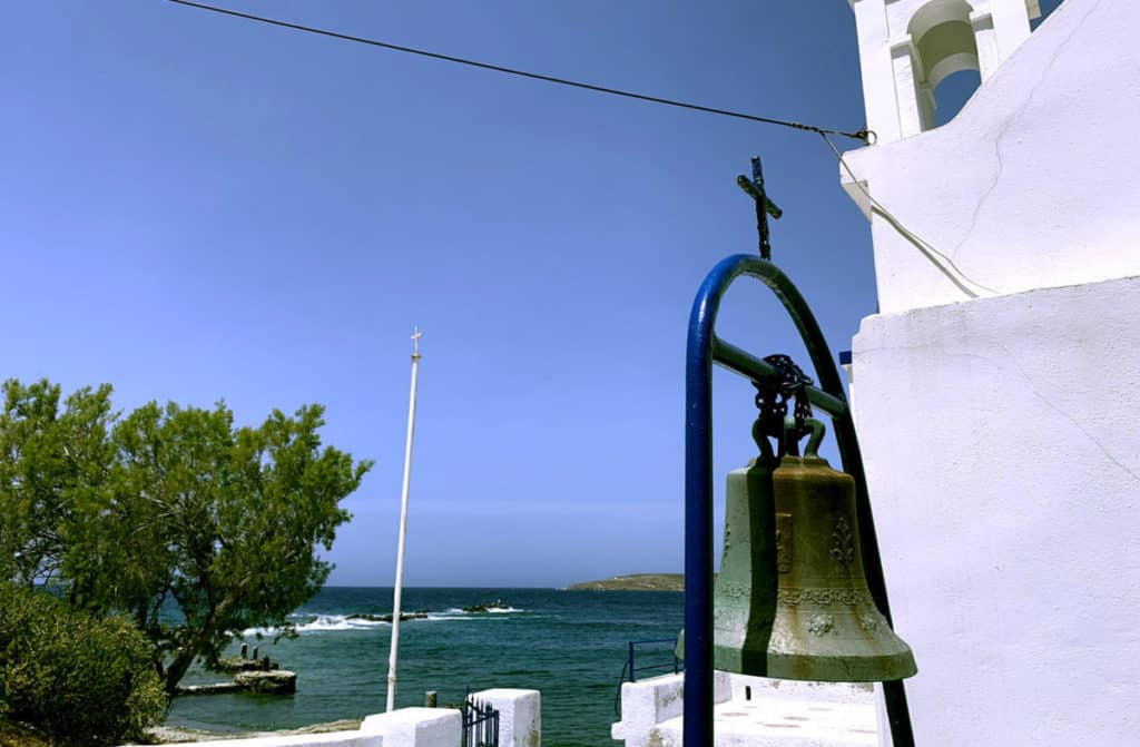 church with bell tower and blue sea