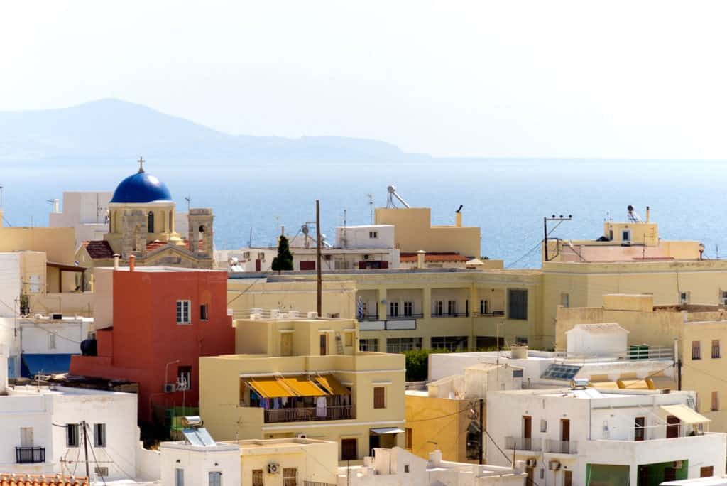 cyclades skippered sailing pretty coloured houses in a greek island village