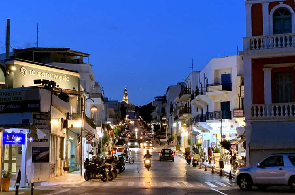 cyclades skippered sailing visits tinos island in the evening lights