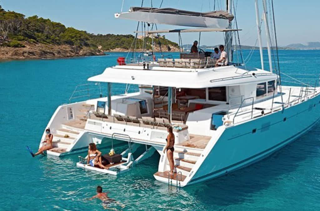 cyclades skippered sailing with luxury catamaran with a family group swimming in the sea
