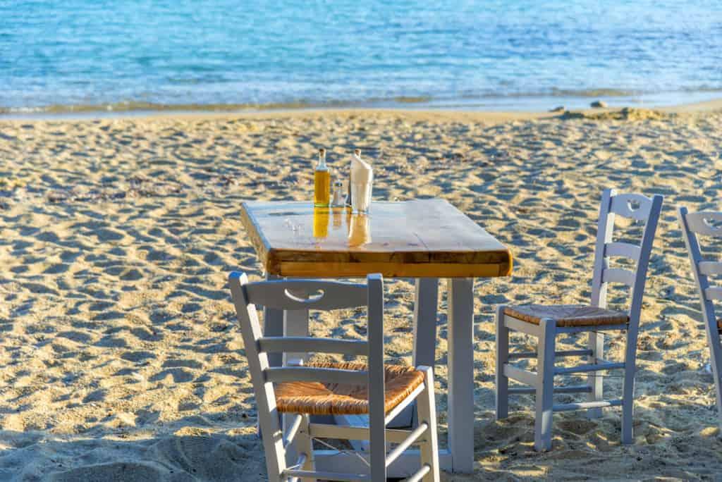 table on a sandy beach in a greek island