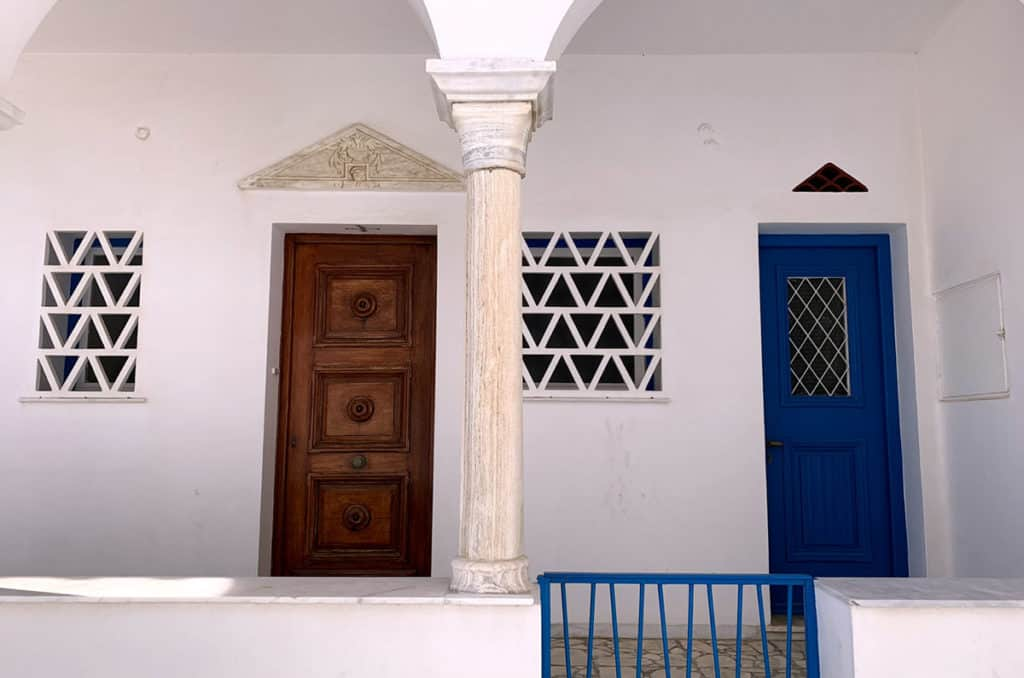 cycladic island white-washed house with blue door