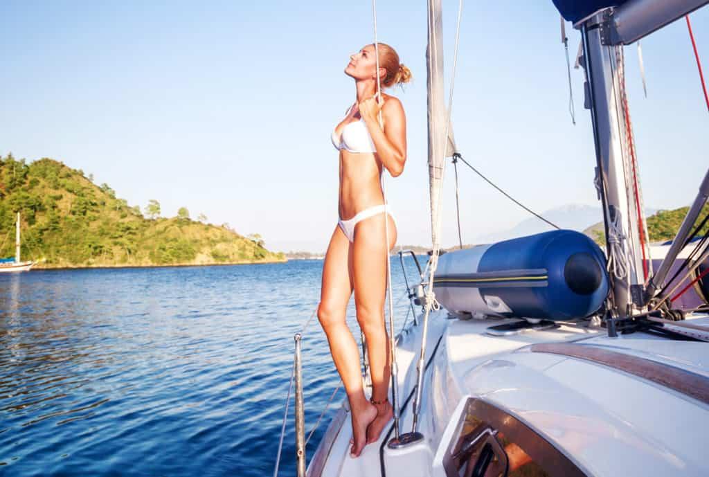 cyclades skippered sailing with a pretty woman enjoying the blue sea views