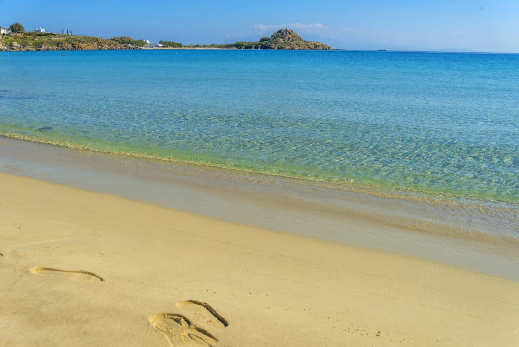 cyclades skippered sailing desearted sandy beach with clear water
