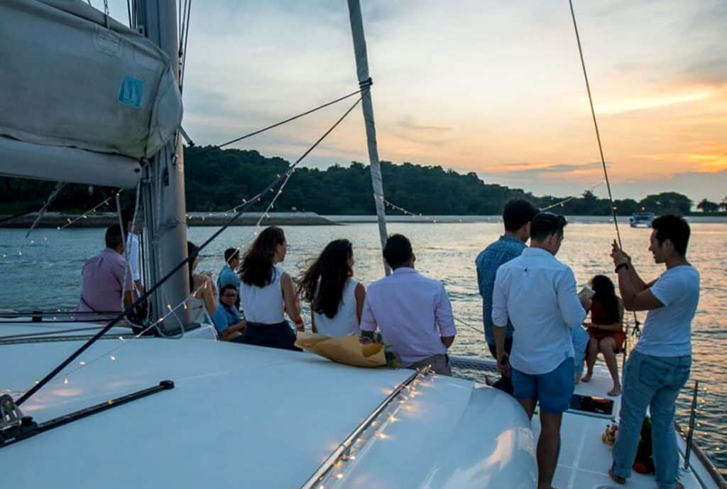 cyclades skippered sailing as a group of friends chat onboard a crewed yacht