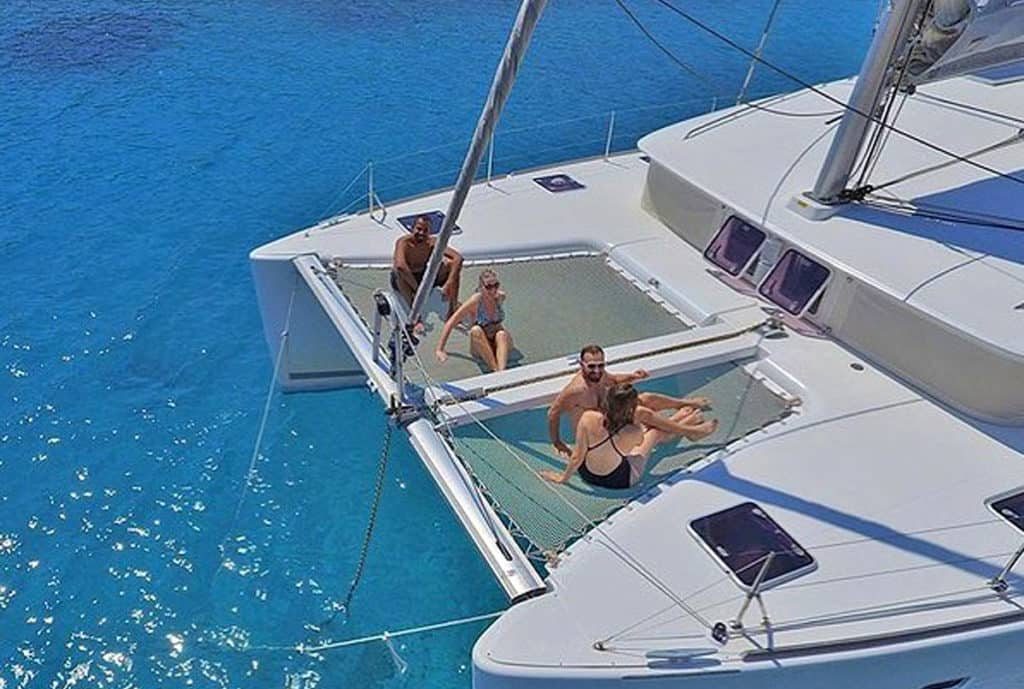 cyclades skippered sailing with catamaran as friends enjoy the sun and sea
