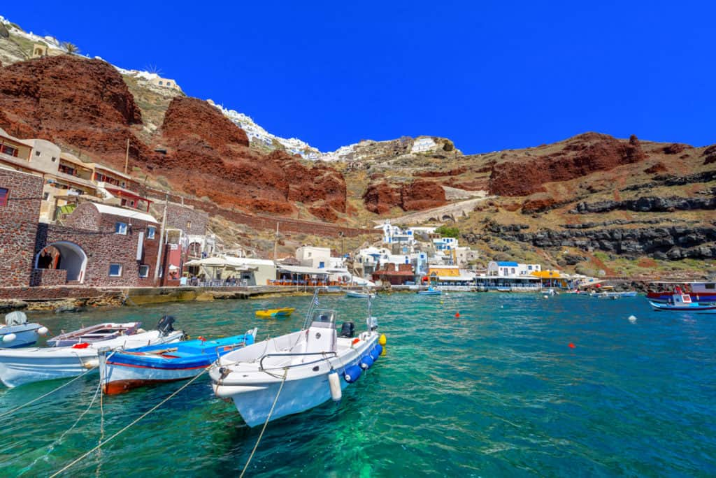 cyclades skippered sailing santorini small secluded bay with pretty fishing boats